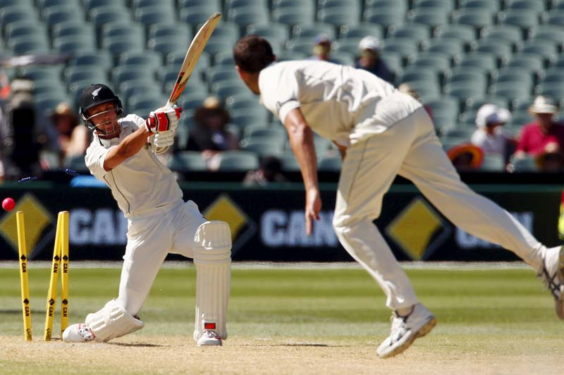 Australia's Josh Hazlewood (right) bowls New Zealand's Trent Boult for five runs during the third day of the third cricket test match at the Adelaide Oval, in South Australia, November 29, 2015. Photo: Reuters