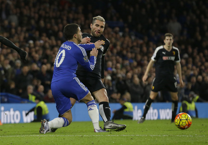 Chelsea's Eden Hazard (left) is brought down for a penalty by Watford's Valon Behrami during the English Premier League soccer match between Chelsea and Watford at Stamford Bridge stadium in London, on Saturday, December 26, 2015.  Photo: AP