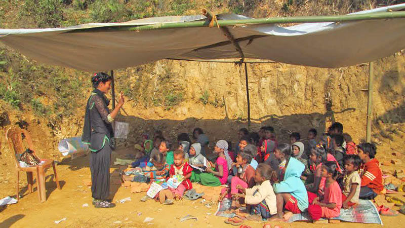 Children reading under tentst in chilling cold in Jamune VDC of Tanahun district on Monday, December 27, 2015. Photo: Madan Wagle