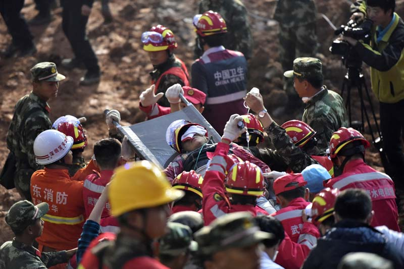 A survivor is found at the site of massive landslide at an industrial park in Shenzhen, south China's Guangdong Province, early Wednesday, December 23, 2015.  Photo: Xinhua News Agency via AP
