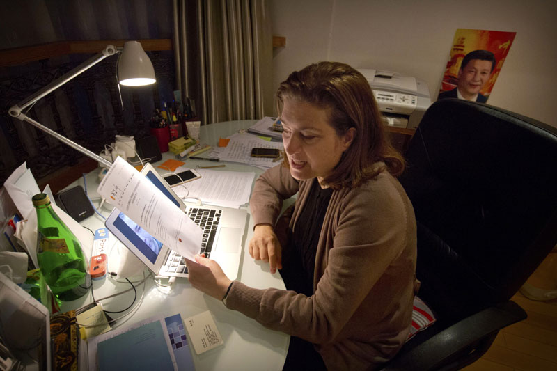 French journalist Ursula Gauthier, a reporter for the French news magazine L'Obs, holds a statement criticizing her from the Chinese Ministry of Foreign Affairs as she sits at her desk in her apartment in Beijing, on Saturday, Dec. 26, 2015. Photo: AP