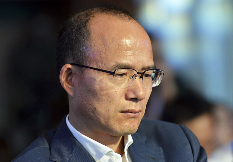 Guo Guangchang attends the opening ceremony of the new Internet bank MYbank in Hangzhou in east China's Zhejiang province on June 25, 2015. Photo: AP