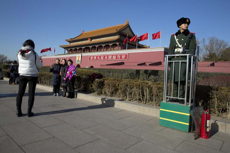 A Chinese paramilitary policeman stands on duty near Tiananmen Gate during a blue sky day in Beijing Friday, December 18, 2015. Photo: AP