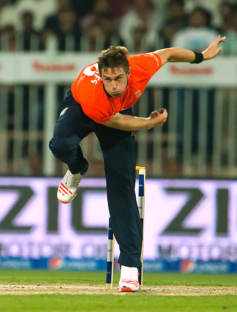 Englandu0092s Chris Woakes bowls during the third Twenty20 match against Pakistan at the Sharjah Cricket Stadium in the UAE on Monday. Photo: AFP