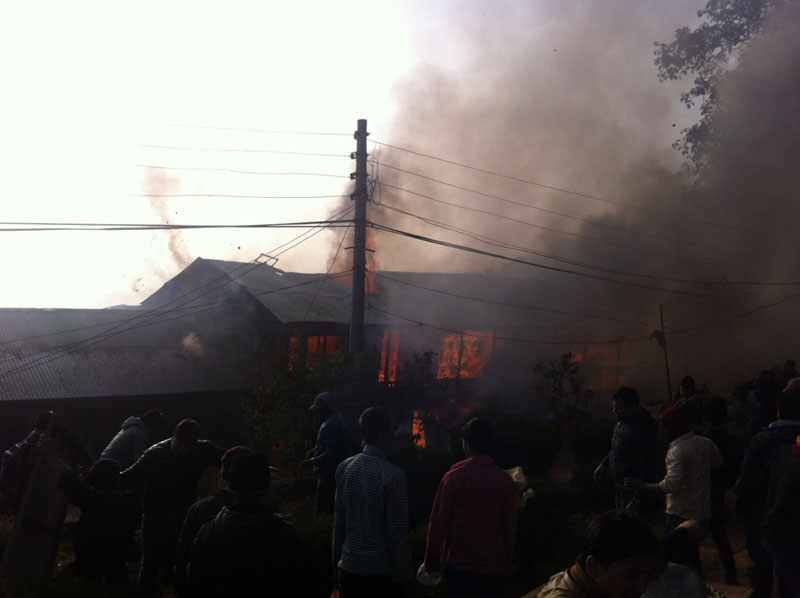 Locals douse the fire sparked in Khotang district headquarters, Diktel, on Thursday, December 17, 2015. Photo: Dilip Khatri
