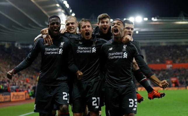 Football Soccer - Southampton v Liverpool - Capital One Cup Quarter Final - St Mary's Stadium - 2/12/15nDivock Origi celebrates with team mates after scoring the fourth goal for LiverpoolnReuters / Eddie Keogh