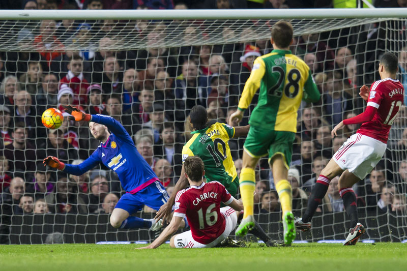 Cameron Jerome of Norwich City (upper centre) scores past Manchester United's goalkeeper David De Gea, (left) during the English Premier League soccer match between Manchester United and Norwich City at Old Trafford Stadium, Manchester, England on Saturday, December 19, 2015. Photo: AP