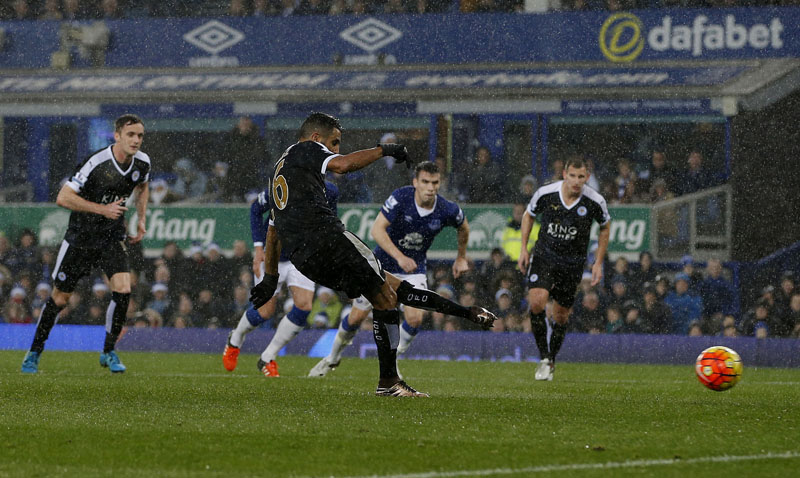 Leicester City's Riyad Mahrez scores against Everton during the English Premier League soccer match at Goodison Park, Liverpool, England on Saturday December 19, 2015. Photo: AP