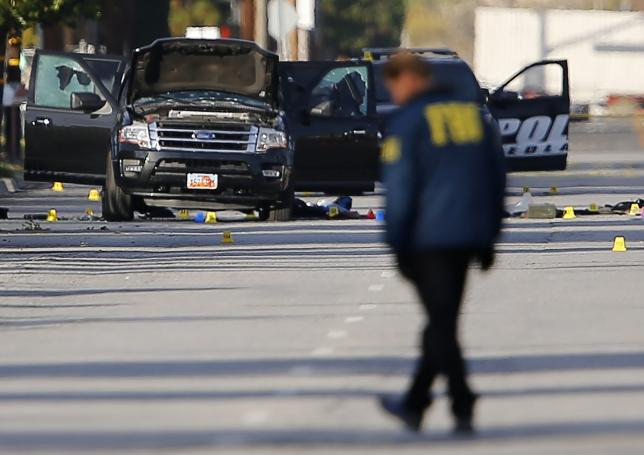 FBI and police continue their investigation around the area of the SUV vehicle where two suspects were shot by police following a mass shooting in San Bernardino, California December 3, 2015.  REUTERS/Mike Blake