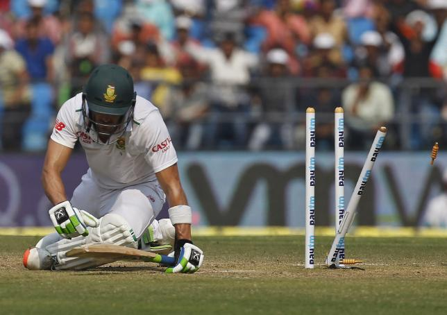 South Africa's Faf du Plessis sits after he was bowled out by India's Amit Mishra during the third day of their third test cricket match in Nagpur, India, November 27, 2015. REUTERS/Amit Dave