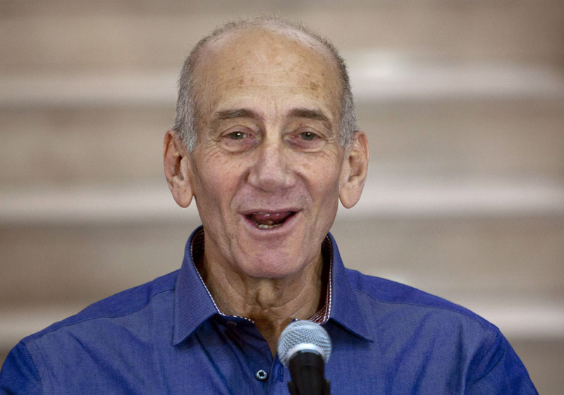 FILE - Former Israeli Prime Minister Ehud Olmert speaks to the media after hearing the verdict in his trial, in Jerusalem's District Court on July 10, 2012. Photo: AP