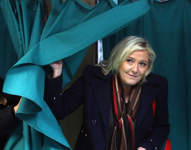 French far-right National Front party leader Marine Le Pen exits from a polling booth prior to posting her ballot for the second round of regional elections on Sunday, December 13, 2015, in Henin-Beaumont, northern France. Photo: AP