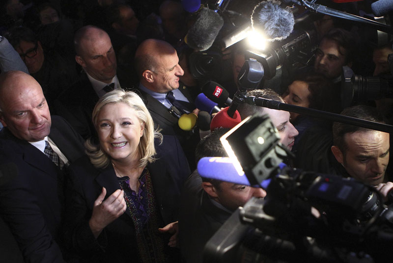 Far Right National Front party leader Marine Le Pen leaves after the second round of the regional elections in Henin-Beaumont, northern France on Sunday, December 13, 2015. Photo: AP