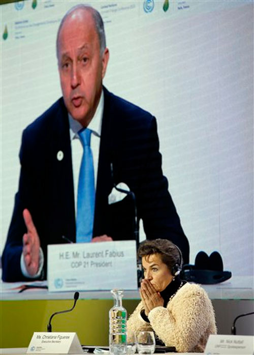 United Nations climate chief Christiana Figueres attends a news conference as French Foreign Minister Laurent Fabius is seen on the screen, at the COP21, the United Nations Climate Change Conference on Wednesday, December 2, 2015 in Le Bourget, north of Paris. Photo: AP