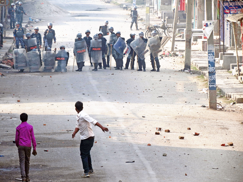 Youth pelt stones at security personnel during a demonstration in Gaur of Rautahat district on Sunday, December 20, 2015. Photo: Prabhat Kumar Jha