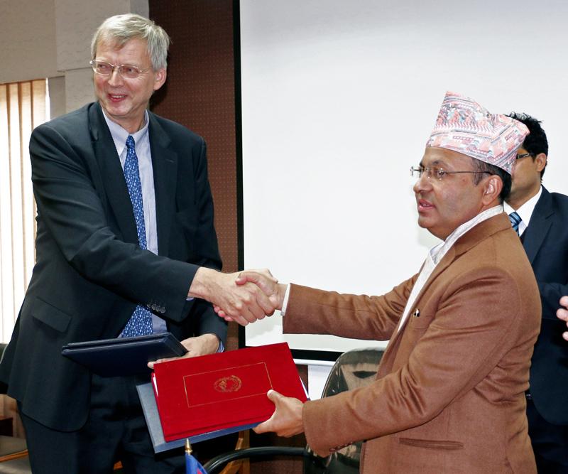 German Ambassador to Nepal Matthias Meier (left) and Finance Secretary Lok Darshan Regmi exchange an agreement at the Ministry of Finance on Monday, December 14, 2015. Photo: RSS