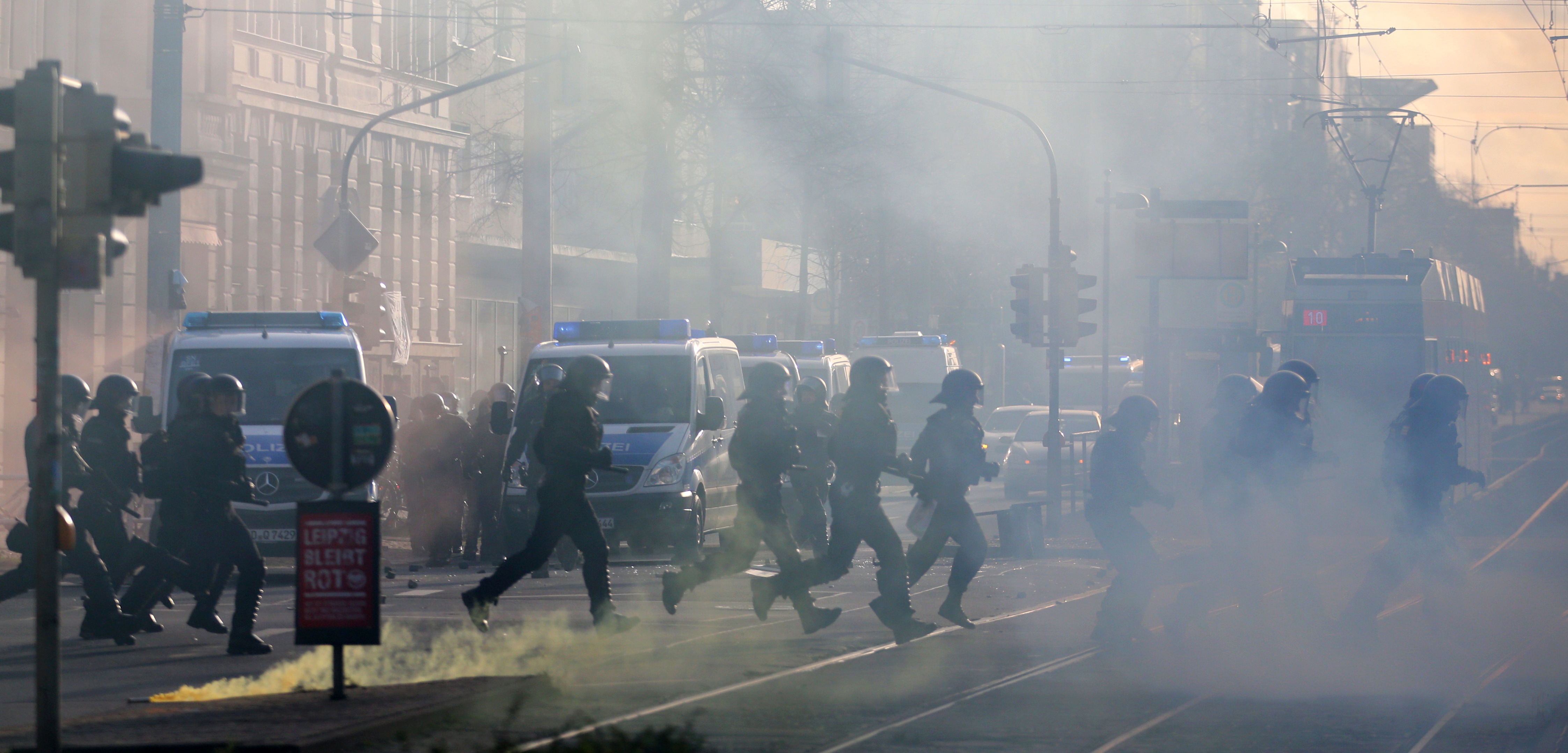 German police  cross a street as they secure the area during clashes with left-wing protesters  in Leipzig,u00a0Germany on December 12, 2015. Photo: Reuters
