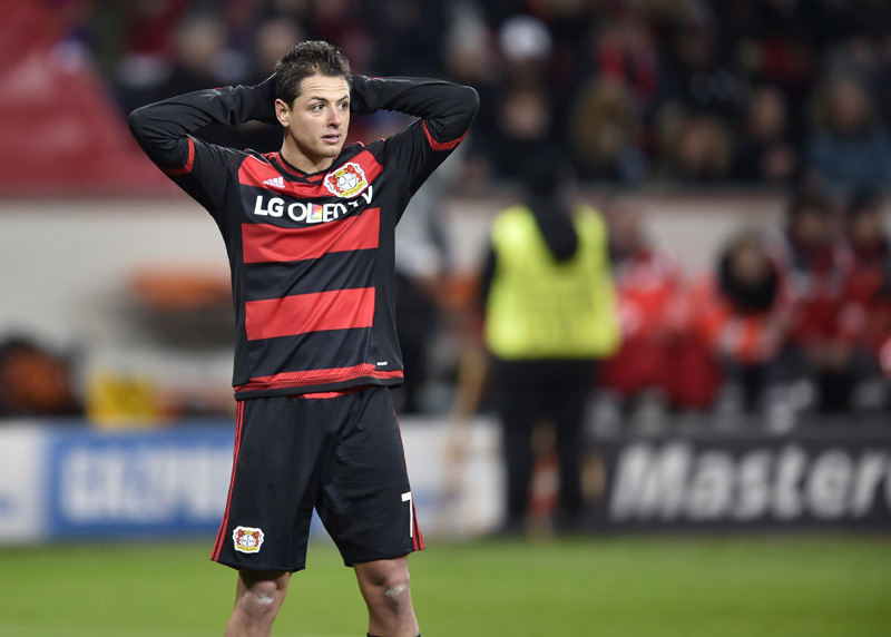 Leverkusen's Javier Hernandez looks on after his team was eliminated from the Champions League at the end of the Champions League Group E soccer match between Bayer Leverkusen and FC Barcelona in Leverkusen, western Germany, Wednesday, Dec. 9, 2015.Photo: AP