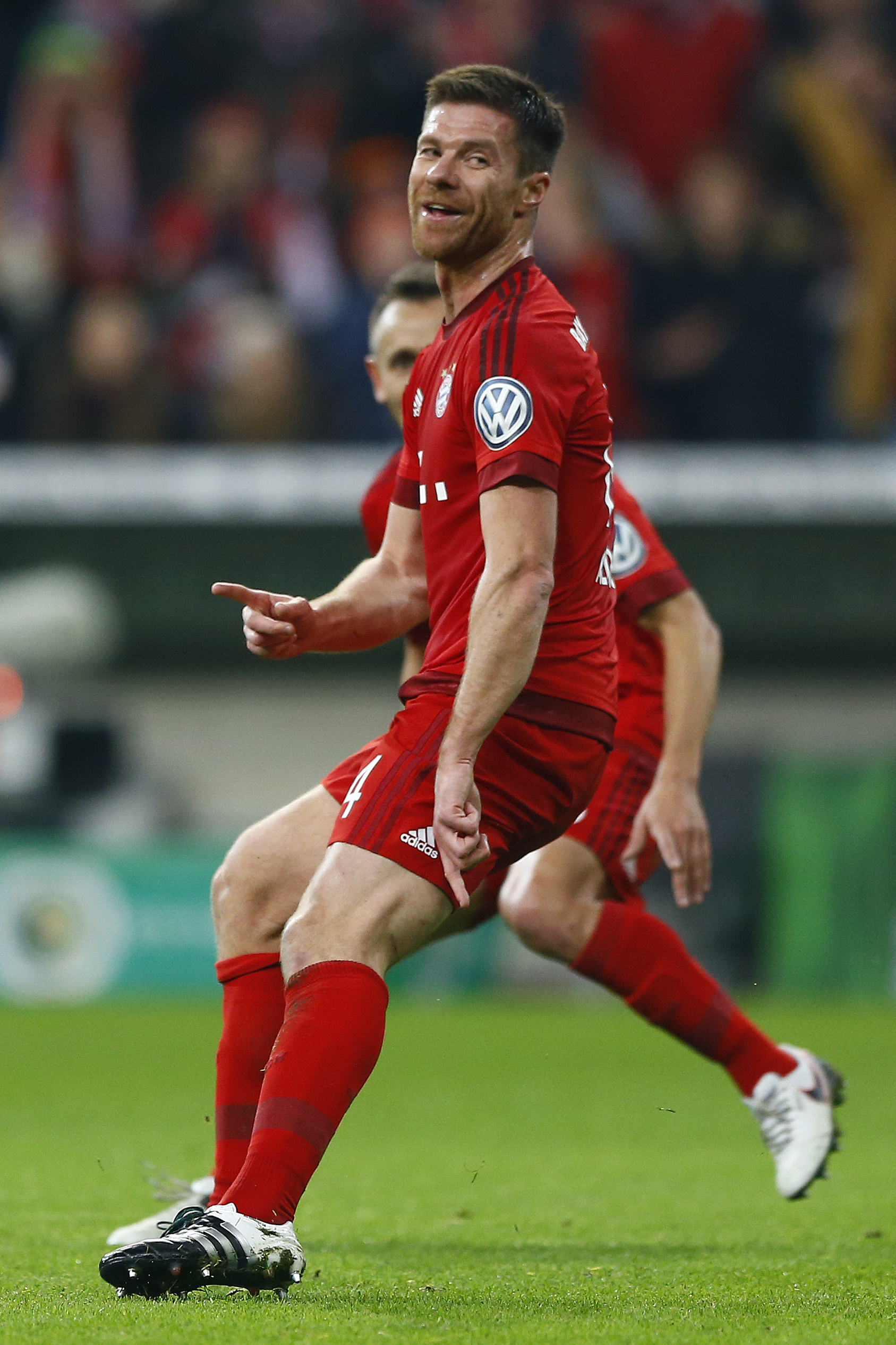 Bayern's Xabi Alonso celebrates after scoring his side's opening goal during the German soccer cup (DFB Pokal) match between FC Bayern Munich and SV Darmstadt 98 at the Allianz Arena on Tuesday, December 15, 2015. Photo: Reuters
