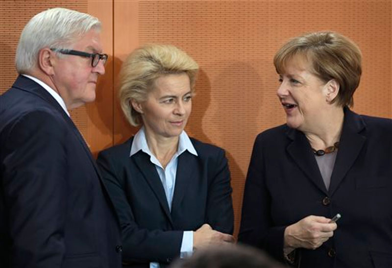 German Chancellor Angela Merkel (right), German Defence Minister Ursula von der Leyen (center), and German Foreign Minister Frank-Walter Steinmeier talk as they arrive for the weekly cabinet meeting in Berlin, Germany on Tuesday, December 1, 2015. Photo: AP