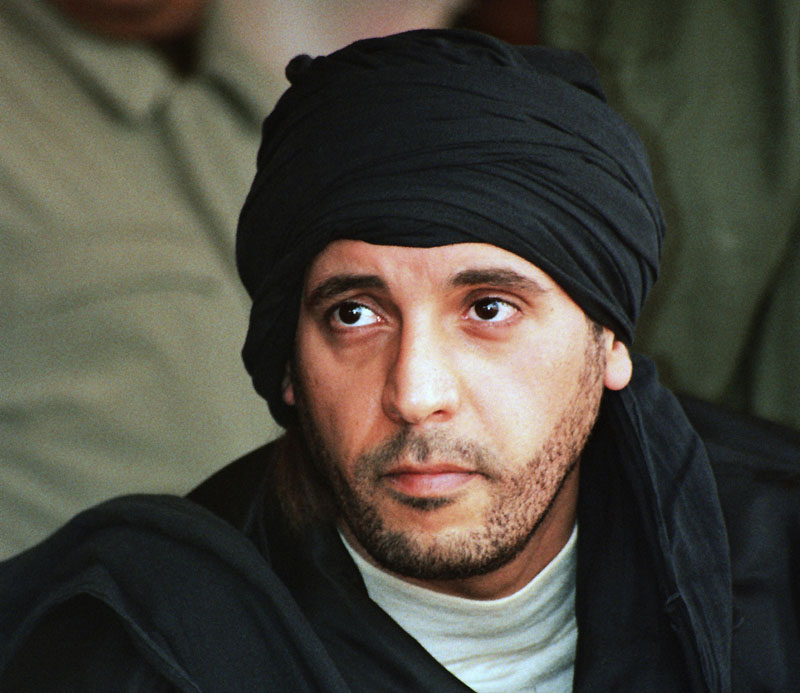 FILE - In this undated file photo made available on September 25, 2011, Hannibal Gadhafi, son of ousted Libyan leader Moammar Gadhafi, watches an elite military unit exercise in Zlitan, Libya. Photo: AP