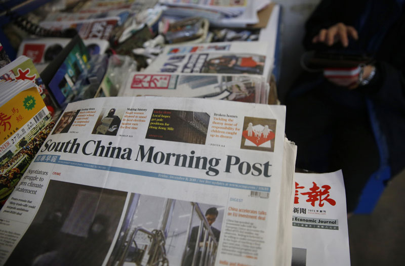 Copies of South China Morning Post are sold at a news stand in Hong Kong on Friday, December 11, 2015. Photo: AP