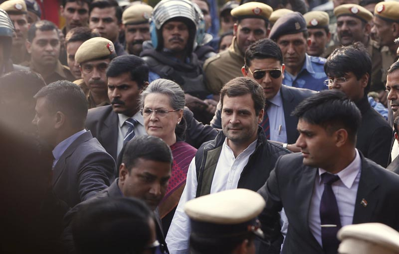 India's main opposition Congress party president Sonia Gandhi (centre-left) and her son and the party's vice-president Rahul Gandhi, arrive at a court in New Delhi, India, December 19, 2015. Photo: Reuters
