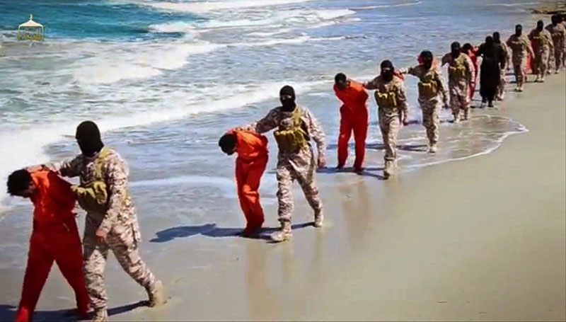 image made from video posted online April on 19, 2015 by supporters of the Islamic State militant group on an anonymous photo sharing website, members of an IS affiliate walk captured Ethiopian Christians along a beach in Libya. The video purportedly shows two groups of captives: one held by an IS affiliate in eastern Libya and the other by an affiliate in the south. A masked militant delivers a long statement before the video switches between footage that purportedly shows the captives in the south being shot dead and the captives in the east being beheaded on a beach. Photo: AP