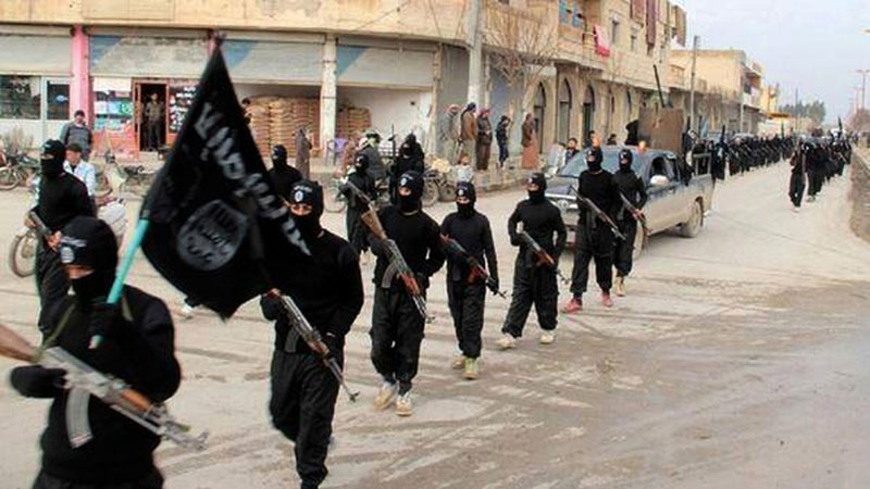 A militant website on Tuesday, January 14, 2014, which has been verified and is consistent with other AP reporting, shows fighters from the al-Qaida linked Islamic State of Iraq and the Levant (ISIL), now called the Islamic State group, marching in Raqqa, Syria. Photo: AP/File