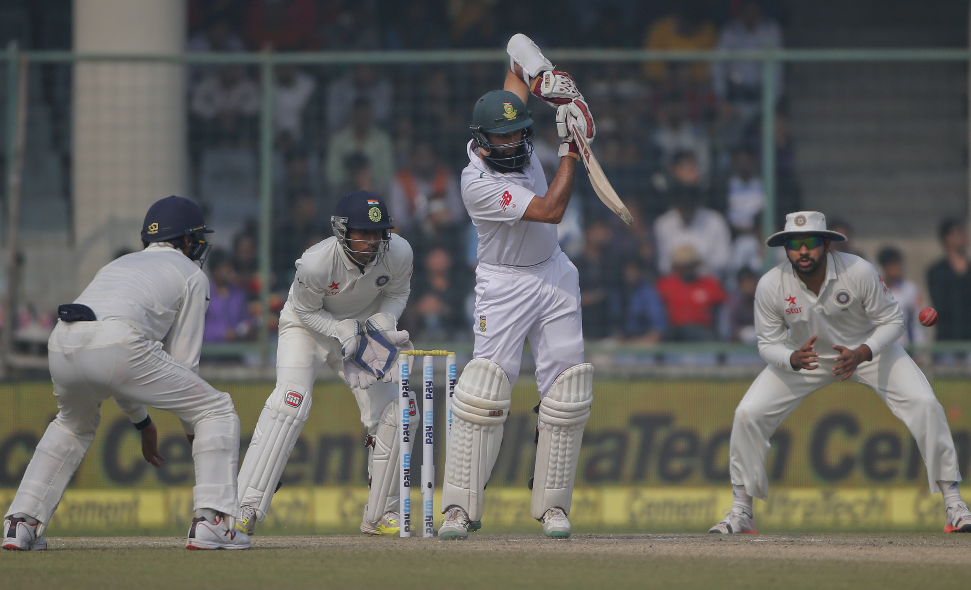 Indian fielders watch as South Africa's captain Hashim Amla bats on day four of their fourth and final test cricket match in New Delhi, India, Sunday, December 6, 2015. Photo: AP
