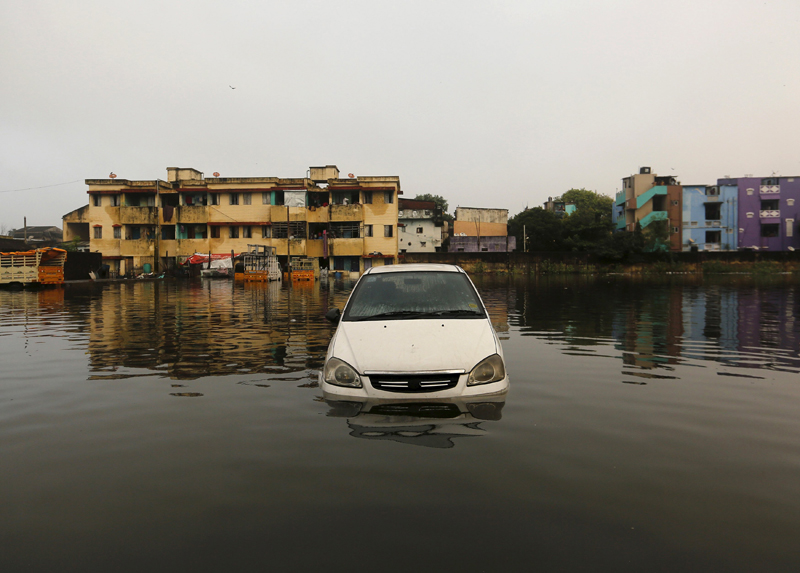 A car is seen in the flood waters at a neighbourhood in Chennai, India, December 4, 2015. Photo: REUTERS