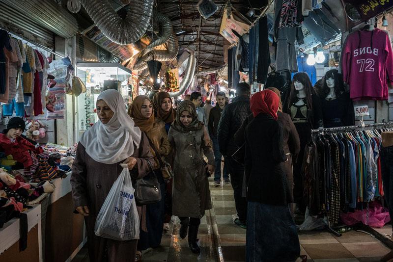 Women shop at Langa popular market, in Irbil, Iraq on Thursday, December 3, 2015. Photo: AP