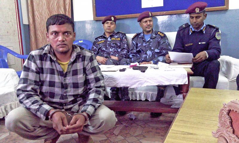 Garudha Area Police Post make public Rakesh Sah  in possession of italian Automatic Pistol on sunday. Photo: Prabhat Jha
