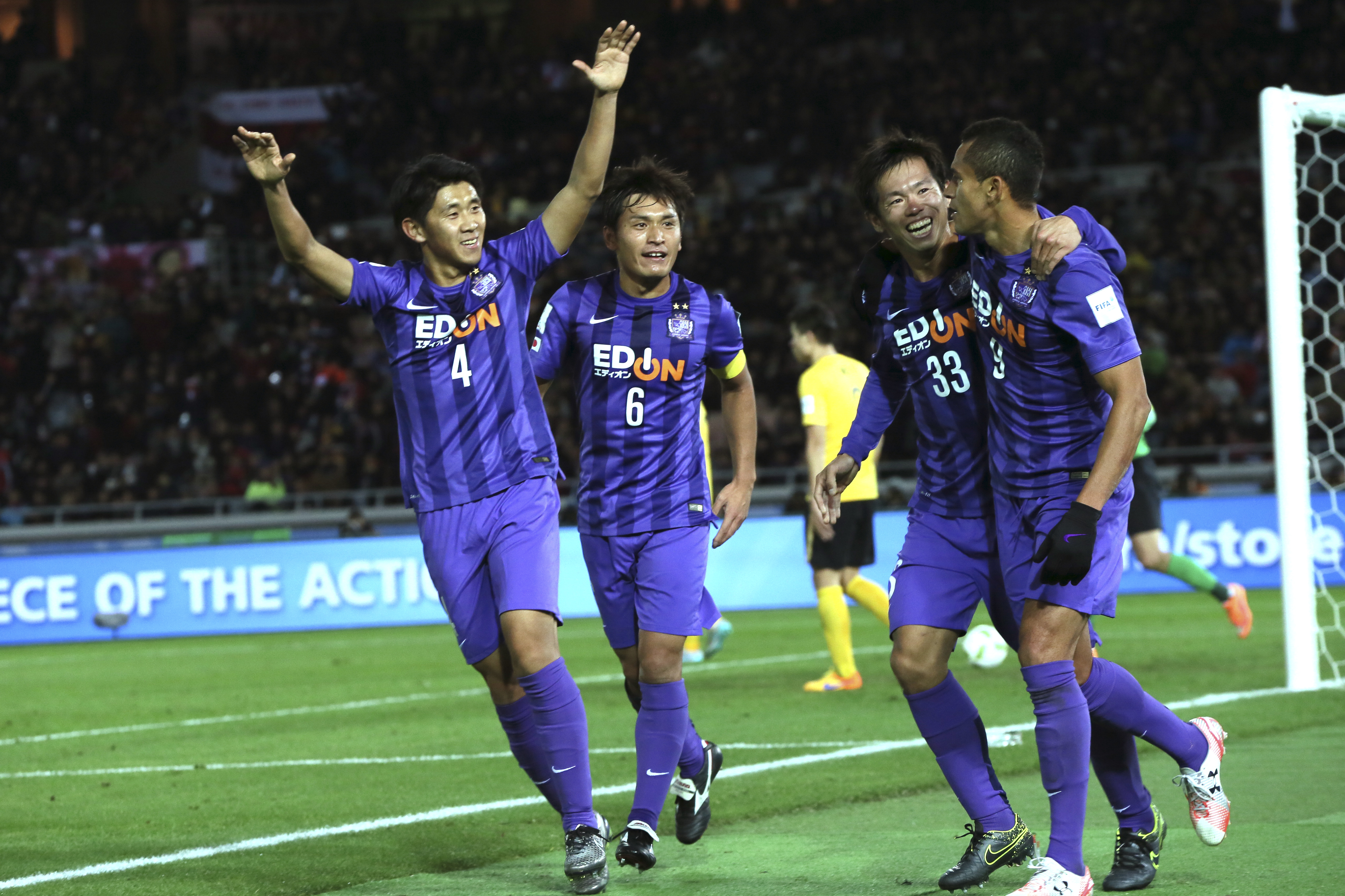 Sanfrecce Hiroshimau0092s Douglas of Brazil, right, is cheered by team mate after scoring against Guangzhou Evergrande during their match for the third place at the FIFA Club World Cup soccer tournament in Yokohama, near Tokyo, Japan, Sunday, Dec. 20, 2015. AP