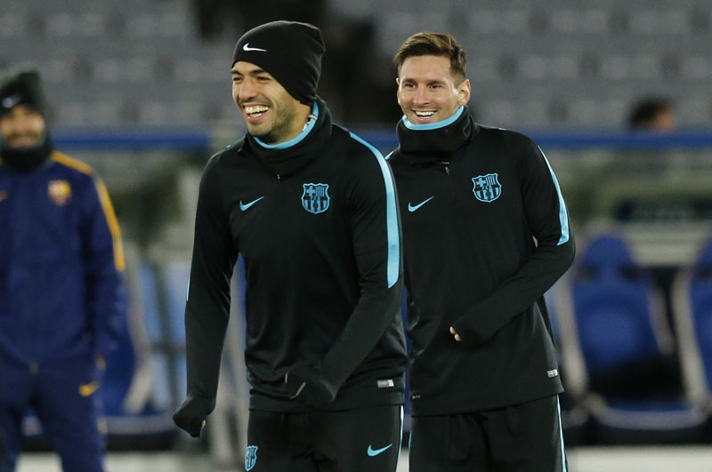 FC Barcelona's Lionel Messi (right) and Luis Suarez smile during a training session, ahead of Sunday's final against Argentine club River Plate at the FIFA Club World Cup soccer tournament in Yokohama, near Tokyo, on Saturday, December 19, 2015. Photo: AP