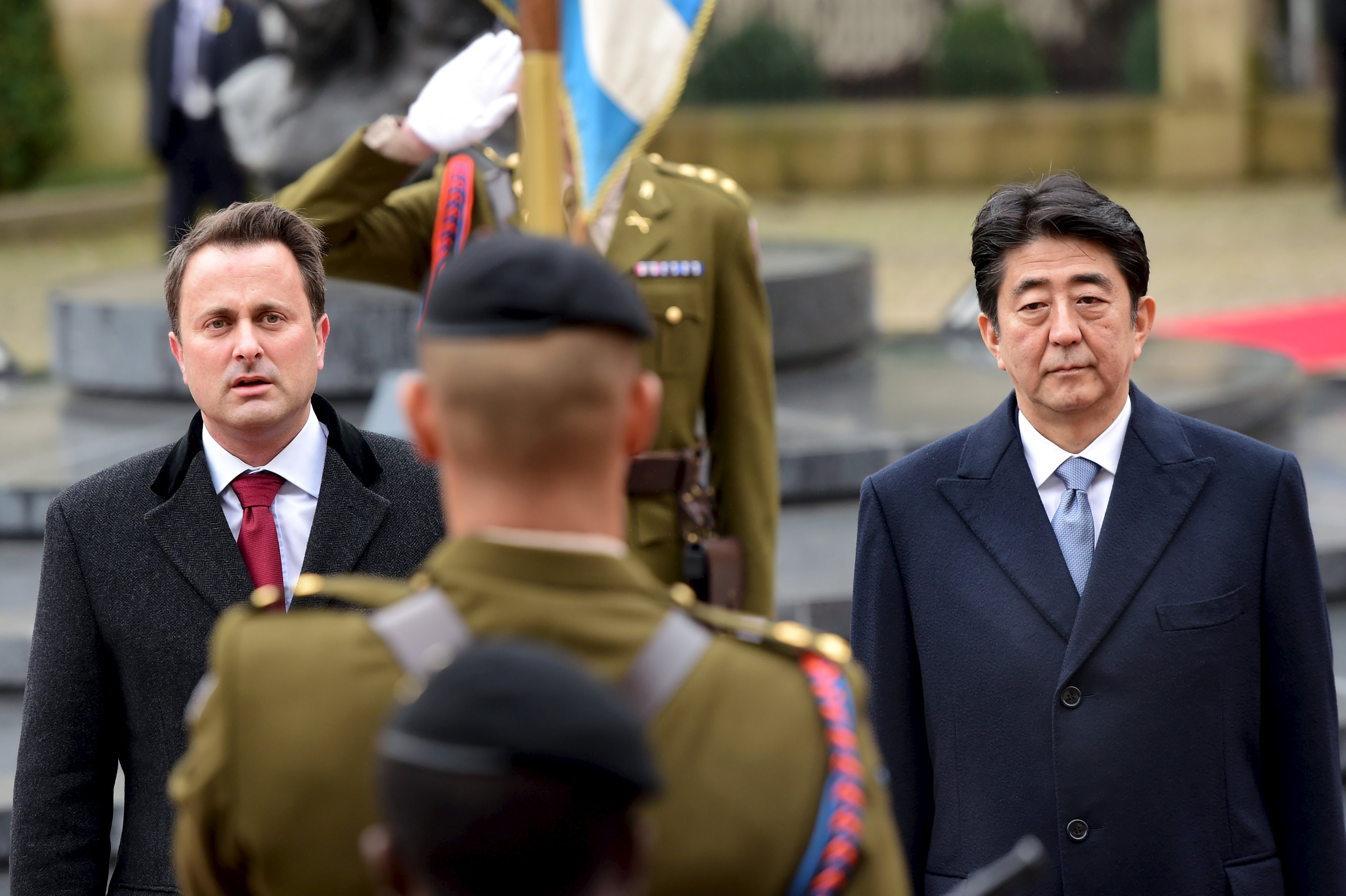 Japanese Prime Minister Shinzo Abe reviews the troops with Luxembourg's Prime Minister Xavier Bettel (not seen) at the start of his official visit in Luxembourg city, Luxembourg December 1, 2015. Photo: Reuters