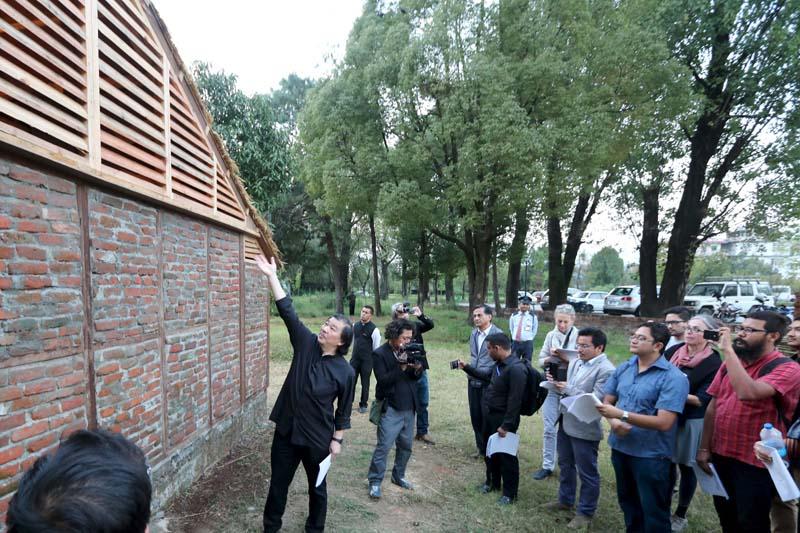 Japanese architect Shigeru Ban (centre) shows a prototype of the Nepal House Project in Kathmandu on October 19, 2015. Photo: Shigeru Ban Architects via Reuters