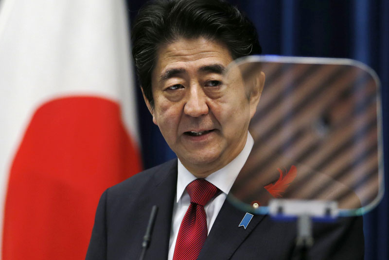 Japan's Prime Minister Shinzo Abe speaks about the agreement on the Trans-Pacific Partnership trade deal at Abe's official residence in Tokyo on October 6, 2015. Photo: AP