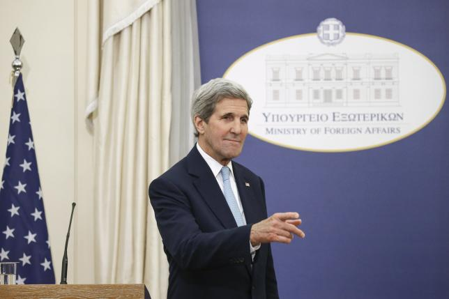U.S. Secretary of State John Kerry gestures following a joint news conference with Greek Foreign Minister Nikos Kotzias (not pictured) at the ministry in Athens, Greece, December 4, 2015. REUTERS/Alkis Konstantinidis