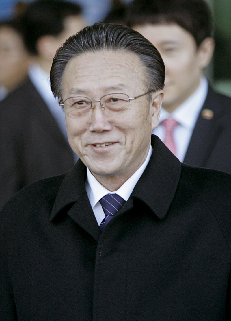 North Korean spy chief Kim Yang Gon smiles upon his arrival at the transit office near the truce village of Panmunjom in the demilitarised zone that separates the two Koreas in Paju, north of Seoul, in this file picture taken November 29, 2007. Photo: Reuters