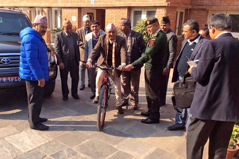 Prime Minister KP Sharma Oli riding the bicycle gifted by Minister for Population and Environment, Bishwendra Paswan under the 'Environment-Friendly National Campaign', at the PM's official residence in Baluwatar on Tuesday, December 29, 2015. Photo: RSS