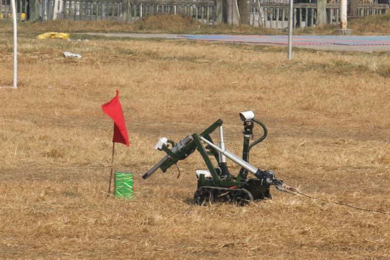 A bomb disposal robot, put together by students of Nepal College of Information Technology, demonstrating a bomb disposal session at Jungi Adda field in Bhadrakali on Tuesday, December 22, 2015. The robot was handed over to Chief of Army Staff Rajendra Chhetri amid a programme. Photo: RSS
