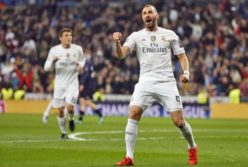 Real Madrid's Karim Benzema celebrates after scoring first goal in Real Madrid v Malmo Champions League Group Stage- Group A match in Santiago Bernabeu, Madrid, Spain, on 8/12/15. Photo: Reuters