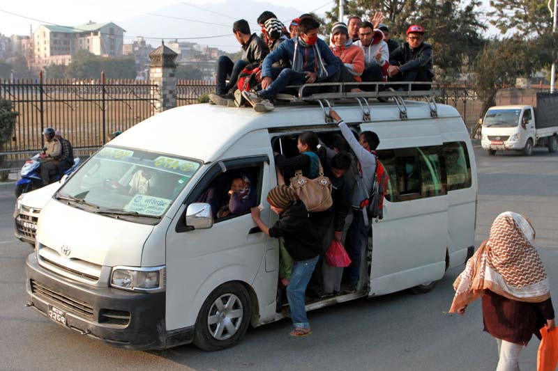 People travelling on a packed micro bus to reach their destination near the Old Bus Park, on Tuesday, December 15, 2015. The ongoing Tarai unrest and de facto blockade has compelled them to travel in an unsafe way. Photo: RSS