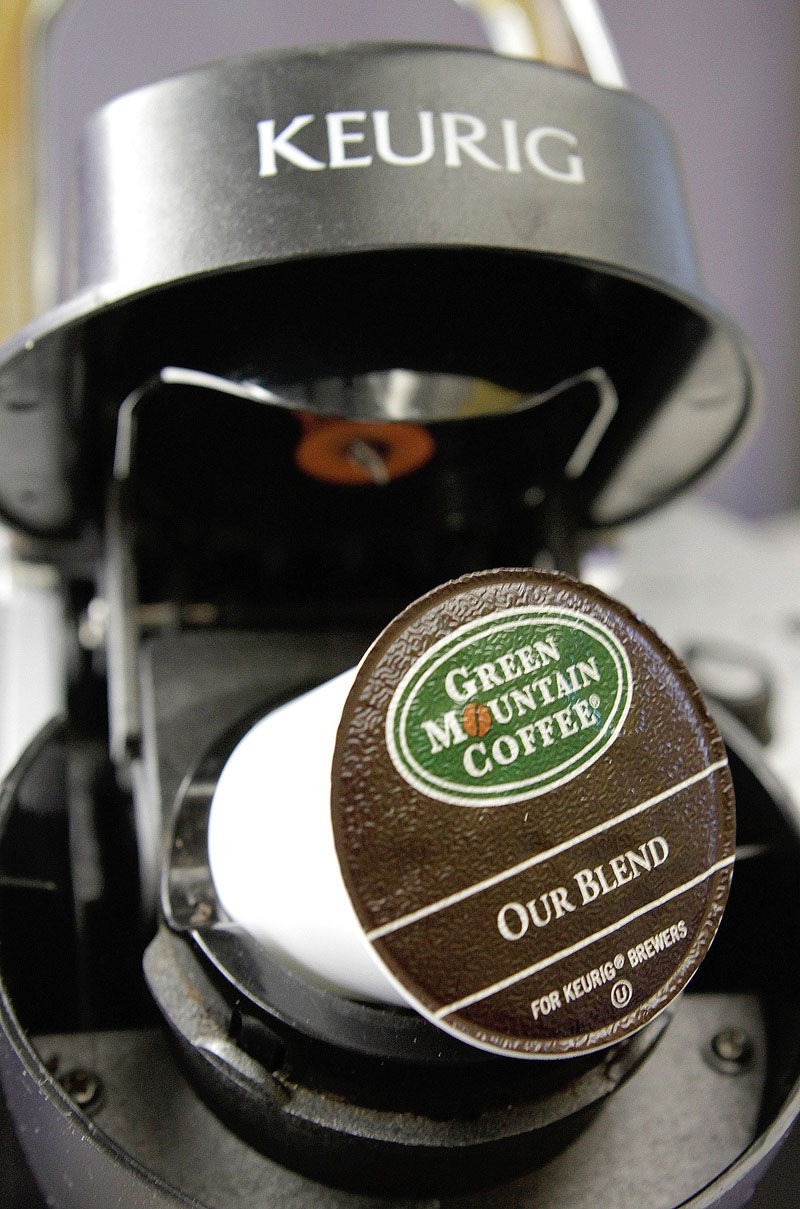 A Green Mountain Coffee single-serving brewing cup is seen in a Keurig machine in Montpelier, Vermont on October 7, 2010. Photo: AP