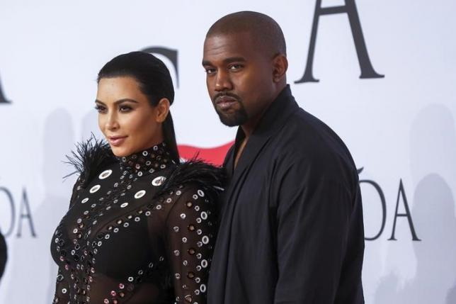 Television personality Kim Kardashian arrives with Kanye West to attend the 2015 CFDA Fashion Awards in New York June 1, 2015.  REUTERS/Lucas Jackson/Files