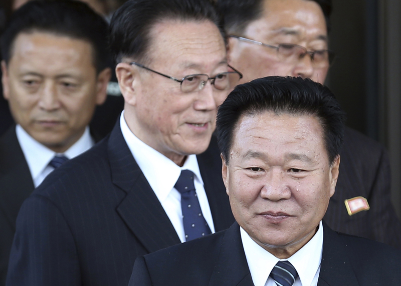 In this Saturday, October 4, 2014 file photo, North Korea's ruling Workers Party Secretaries, Kim Yang Gon (centre) and Choe Ryong Hae (right) leave after a meeting with South Korean officials at a hotel in Incheon, South Korea.  Kim, North Korea's top official in charge of relations with South Korea has died in a car accident, the country's state media announced Wednesday, December 30, 2015. Photo: AP