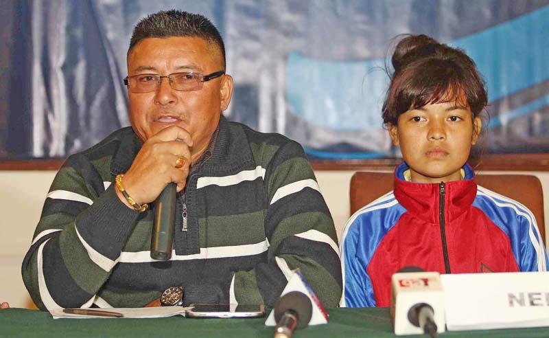 Nepal U-14 girls' team coach Kishor KC gestures as skipper Puja Rana looks on during a press meet in Kathmandu on Saturday. Photo: Udipt Singh Chhetry/THT
