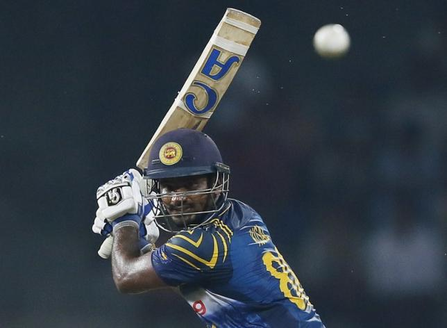 Sri Lanka's Kusal Perera hits a boundary during the second One Day International cricket match against West Indies in Colombo November 4, 2015. REUTERS/Dinuka Liyanawatte