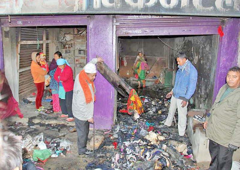 The shops that were gutted by fire in Phidim bazaar of Panchthar district on Tuesday, December 29, 2015. Photo: Laxmi Gautam